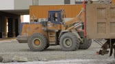 site : Grader working at building site Stock Footage
