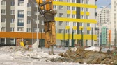 many storied : Hydrohammer machine working at building site Stock Footage