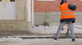 asfalt : Street cleaner removing snow from road