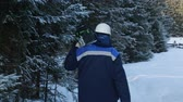 lumbering : Worker with chain saw on shoulder going to the forest Stock Footage