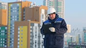 supervise : Foreman with tablet at major construction project Stock Footage