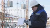 заметка : Engineer with tablet at electric power station
