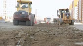 дизель : Road-roller and grader working at construction site