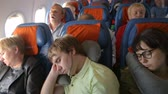 fotel : People sleeping in the airplane
