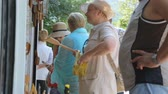 wooden spatula : Group of tourists shopping in street shop