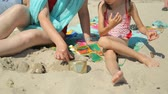 ręcznik : Woman and child playing with sand on beach
