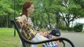 patterned : Woman with daughter in public park Stock Footage