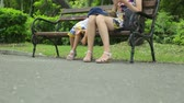 yorgunluk : Woman with daughter in public park Stok Video