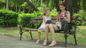 green area : Woman with daughter in public park Stock Footage