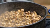 houby : Mushrooms cooked in a large pot