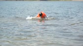 bath : Girl in life jacket in water
