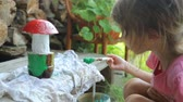 setas : Little girl coloring garden decoration