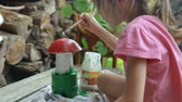 yardım : Little girl coloring garden decoration