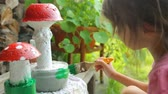 поганка : Little girl coloring garden decoration
