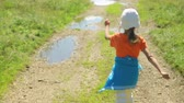 road : Little girl walking along a rural road