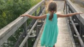 Little girl on an old bridge