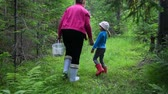 unoka : Woman with little girl walking in forest