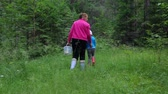setas : Woman with little girl walking in forest