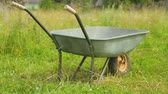 tekerlekler : Metal wheelbarrow on field