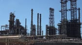 industrial : Abstract and conceptual of petroleum or refinery industry. Modern life, civilization, well-being, but also pollution and degradation Stock Footage
