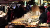 enchilada : Hot food cooking at a busy market