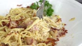 slow motion of Spaghetti Carbonara with fork