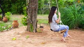 woman playing on swing in garden