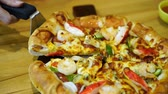 pizza with seafood on wood table Vídeos