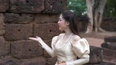 slow motion of woman in Thai traditional dress is walking