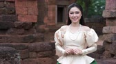 woman in Thai traditional dress is pay respect