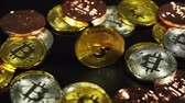 madencilik : rotating of cryptocurrency physical gold bitcoin on black background, new virtual money Stok Video