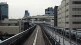 monorail : TOKYO, JAPAN - MARCH 28, 2019; Scenery of a train traveling on the rail of Yurikamome Line in Tokyo from Shimbashi station to Odaiba. Stock Footage
