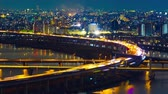 útkereszteződés : time lapse of highway road bridge with Arakawa river in Tokyo at night, Japan Stock mozgókép