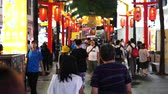 road sign : Taipei, Taiwan- 8 June, 2019: Crowd of people walking and shopping at Ximending street market at night in Taipei, Taiwan. Ximending is the famous fashion, night Market and street food in Taipei.
