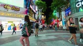 дорожный знак : Taipei, Taiwan- 8 June, 2019: time lapse of Crowd of people walking and shopping at Ximending street market at night in Taipei, Taiwan. Ximending is the famous fashion, night Market and street food in Taipei.