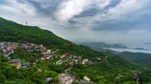 thee : time lapse of of Jiufen village with mountain and east china sea, Taiwan