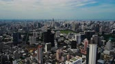 apartment buildings : panning shot of Bangkok cityscape view from highest observation deck at Mahanakhon building, Thailand