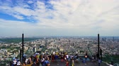 skywalk : Bangkok, Thailand – Jul 27, 2019 : Unidentified people with panoramic view on 78th floor at King Power Mahanakhon building rooftop, Bangkok, Thailand Stock Footage