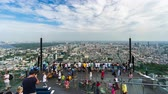 skywalk : Bangkok, Thailand %u2013 July 27, 2019 : time lapse of unidentified people with panoramic view on 78th floor at King Power Mahanakhon building rooftop, Bangkok, Thailand Stock Footage