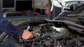 mechanic hand using Tachometer checking engine of a car