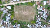 football field sitting among poor houses in a village of zanzibar, tanzania, aerial, topview