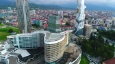 Batumi, Georgia - 27 August 2017: Panoramic aerial drone view of modern buildings of downtown of Batumi. Batumi technical university tower, Radisson Blu Hotel and Palm apartments from above Стоковые видеозаписи
