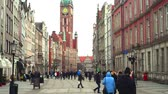 Poland, Gdansk - March 17, 2015: people walk at Long Market Square (Dluga Street) beside Gdansk Historical Museum Стоковые видеозаписи