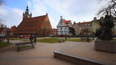 Poland, Gdansk - March 17, 2015: people walk beside the Great mill and monument to Jan Hevelius