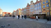 Poland, Gdansk - March 17, 2015: people walk at Long Market Square (Dluga Street) with pigeons Стоковые видеозаписи