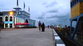 estância turística : Batumi, Georgia - August 29, 2017: People walking on the quay of Batumi in the evening. Tourists on the embankment of Batumi taking photos and passing by moored vessels in port