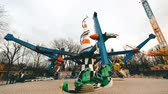 Ukraine, Kharkiv - April 09, 2018: A roundabout with twirling airplanes in slow motion at Gorky park