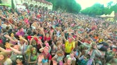 tłum : Kharkiv, Ukraine - May 19, 2018: People celebrating holi festival with hands waving at concert