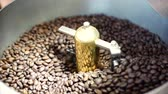 espeto : Mixing of roasted coffee. Partial removal of bad grains. The roasted coffee beans got on the mixer sorting by a professional machine. Slow motion.