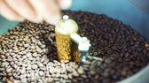 coffee machine : Mixing of roasted coffee. Partial removal of bad grains. The roasted coffee beans got on the mixer sorting by a professional machine. Slow motion.